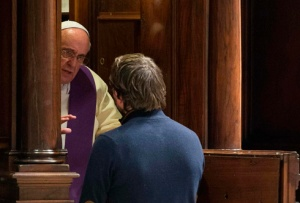 Pope Francis hears confession from a man during a penitential liturgy in St. Peter's Basilica at the Vatican March 28. Pope Francis surprised his liturgical adviser by going to confession during the service. (CNS photo/L'Osservatore Romano via Reuters) (March 31, 2014) See POPE-PENANCE March 28, 2014.